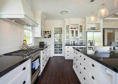 White-Cabinets-Dark-Granite-BaahouseBaastudio-Queenslander-Kitchen-870x579