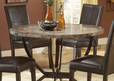 round-granite-dining-table-set-with-adorable-table-base-plus-four-brown-leather-dining-chairs-and-pretty-vase-as-a-centerpiece